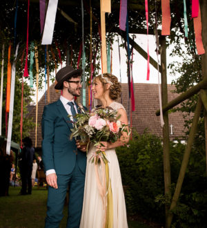 Bride and groom celebrating at Clock Barn © Ian Martindale Photography