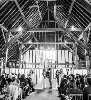 Bride, groom and family in clock barn © Mia Photography