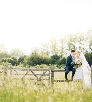 Couple in the grounds at Clock Barn © Jacob and Pauline Photography