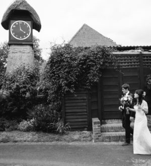 Bride and groom together outside of Clock Barn © Lydia Stamps Photography