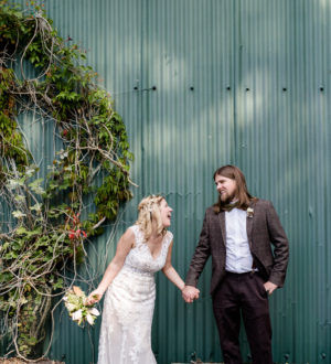 Bride and groom outside Clock Barn © Lydia Stamps Photography