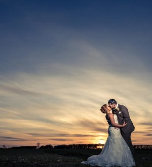A wedding couple in the evening at Clock Barn © DM Photography