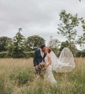 Bride and groom in the outdoor space at Clock Barn  © Tom Halliday Photography