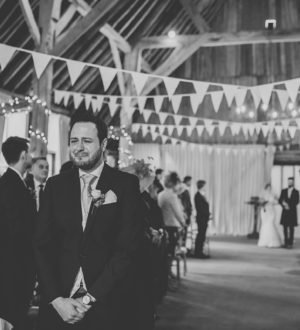 Groom waiting for his bride at Clock Barn   © Tom Halliday Photography