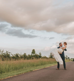 Bride and groom on the driveway to Clock Barn  © Tom Halliday Photography