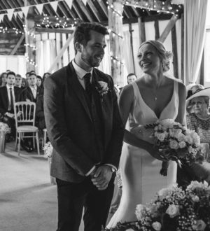 Bride and groom at their wedding ceremony in Clock Barn © Jackson & Co Photography
