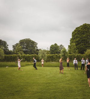 Bride and groom playing in the open garden space © Jackson & Co Photography