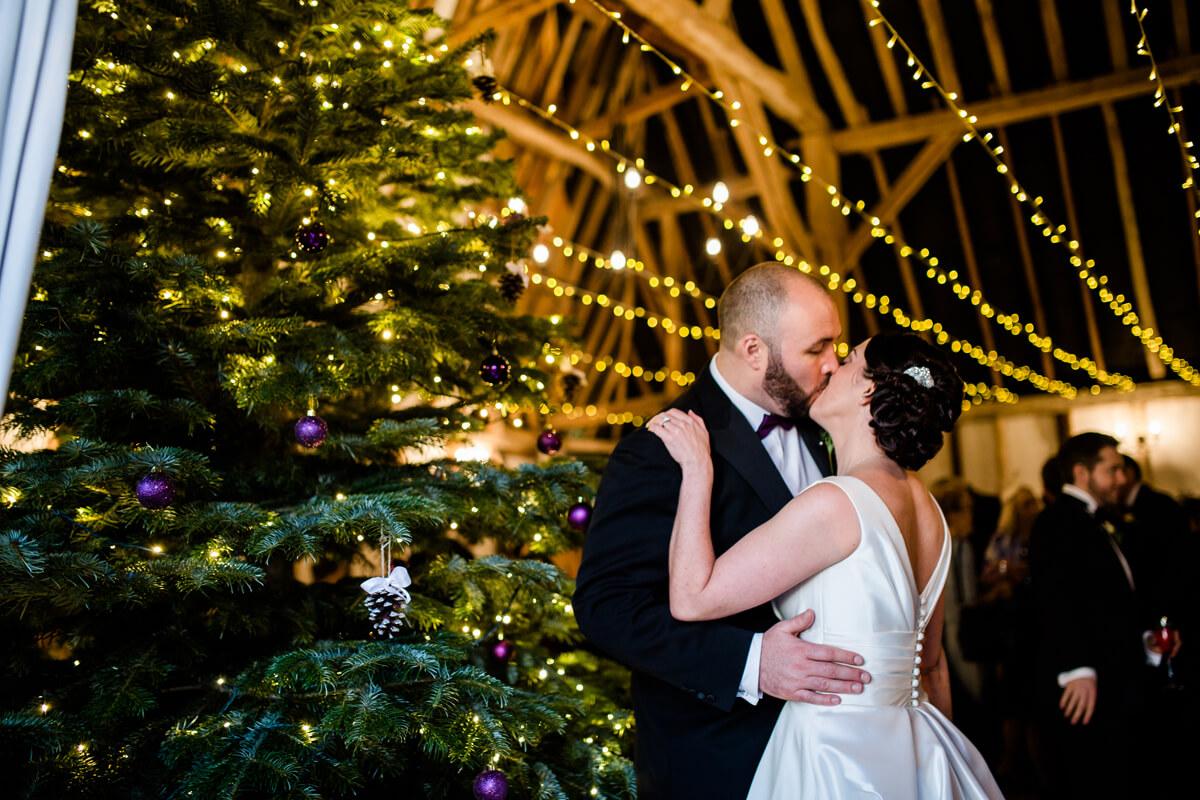 A Christmas Wedding.Bride And Groom Kiss Christmas Wedding Clock Barn Wedding