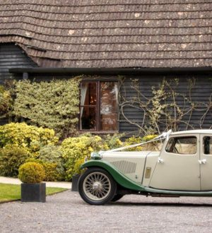 Arrived in style at Clock Barn © Julia Conway Photography