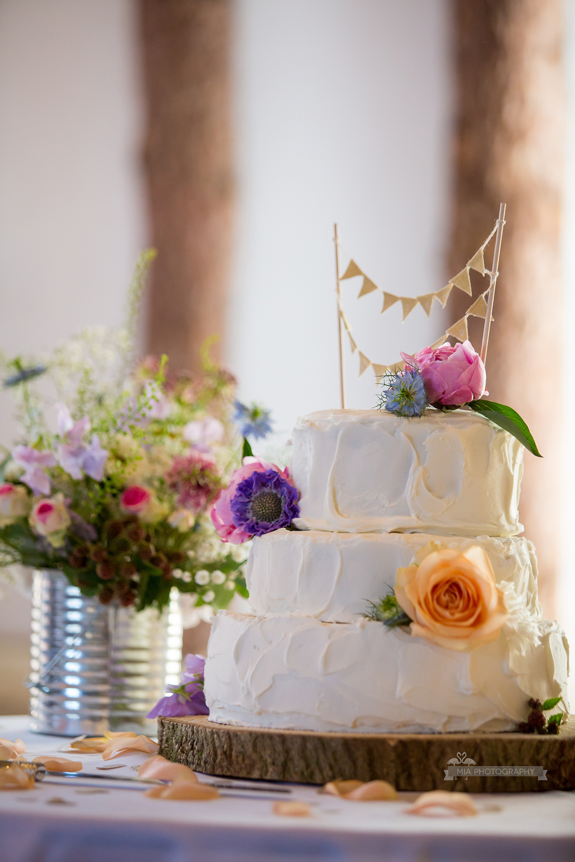 Buttercream wedding cake with flower decorations