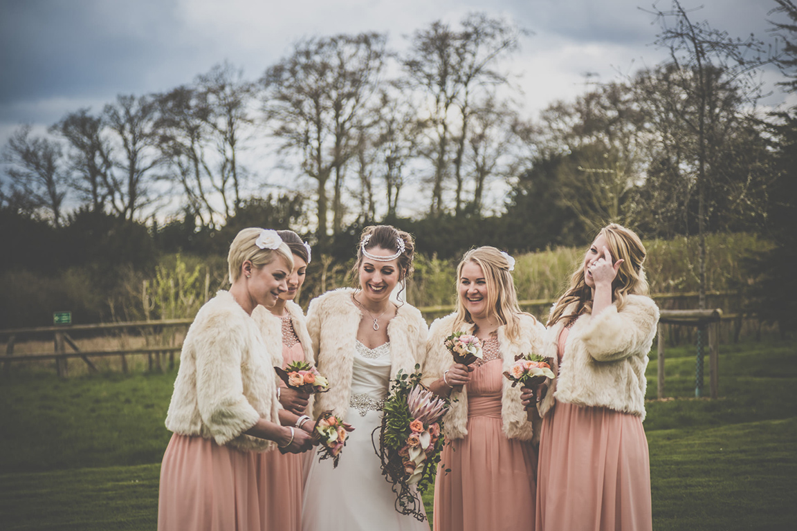 Bride and bridesmaids peach themed wedding outfits