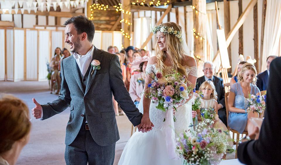 Couple stood at the altar at Clock Barn