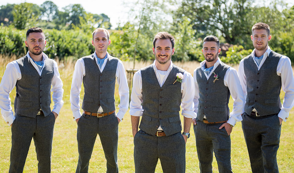 Groom and groomsmen with matching wedding outfits