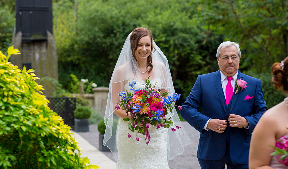 Rebecca makes her way to the wedding ceremony with her father – wedding ceremony venues Hampshire