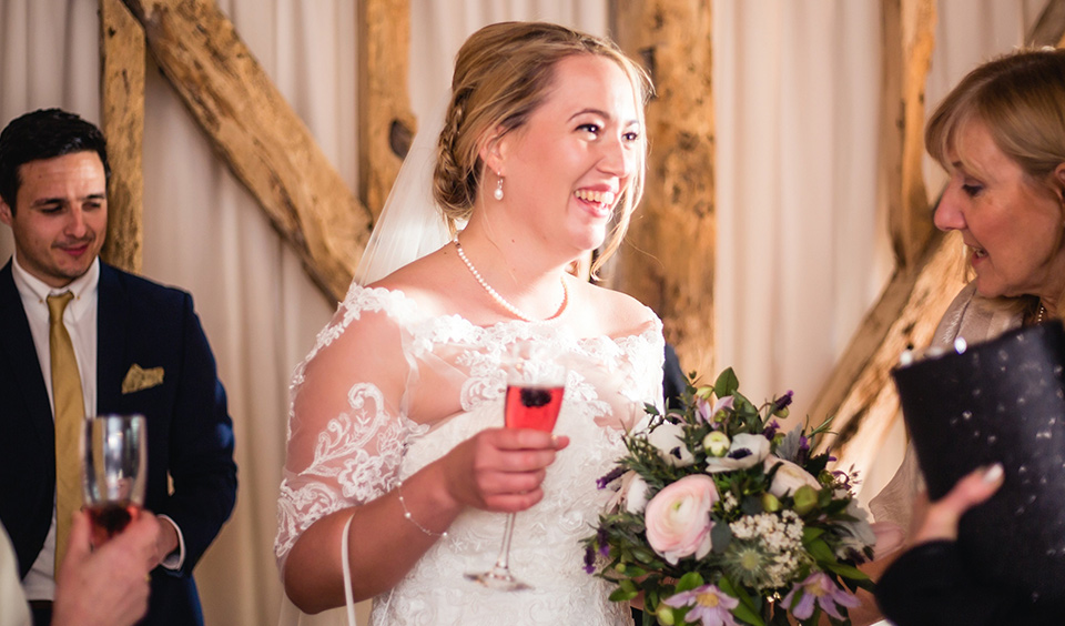 An intricate dress and delicate pearls made Emily's look extra-special for her Clock Barn wedding