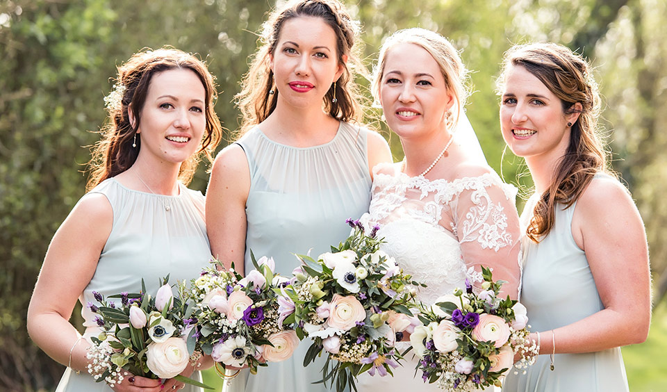 A delicate colour choice for the bridesmaid's dresses was ideal for this wedding at Clock Barn.