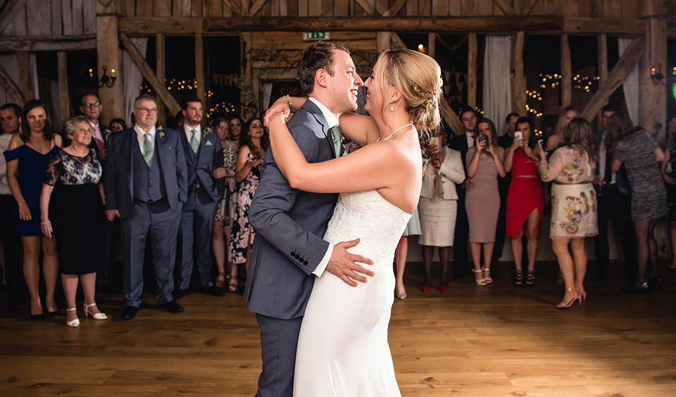 Emily and Tom held their first dance in the stunning Great Barn as all their guests watched on.