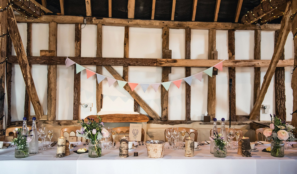 Colourful bunting was the perfect way to decorate this breathtaking barn wedding venue