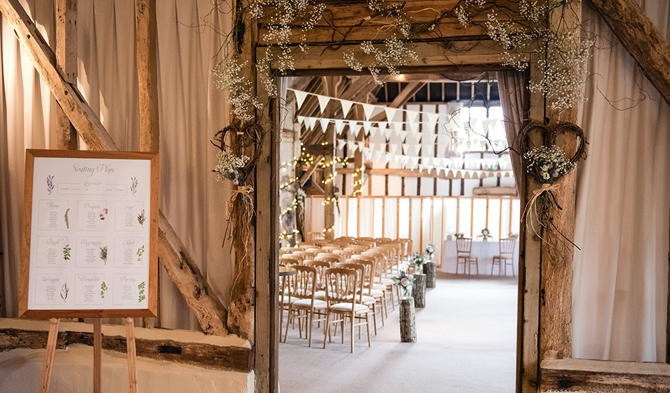 Gypsophila and natural decorations were the perfect accompaniment for this country wedding venue
