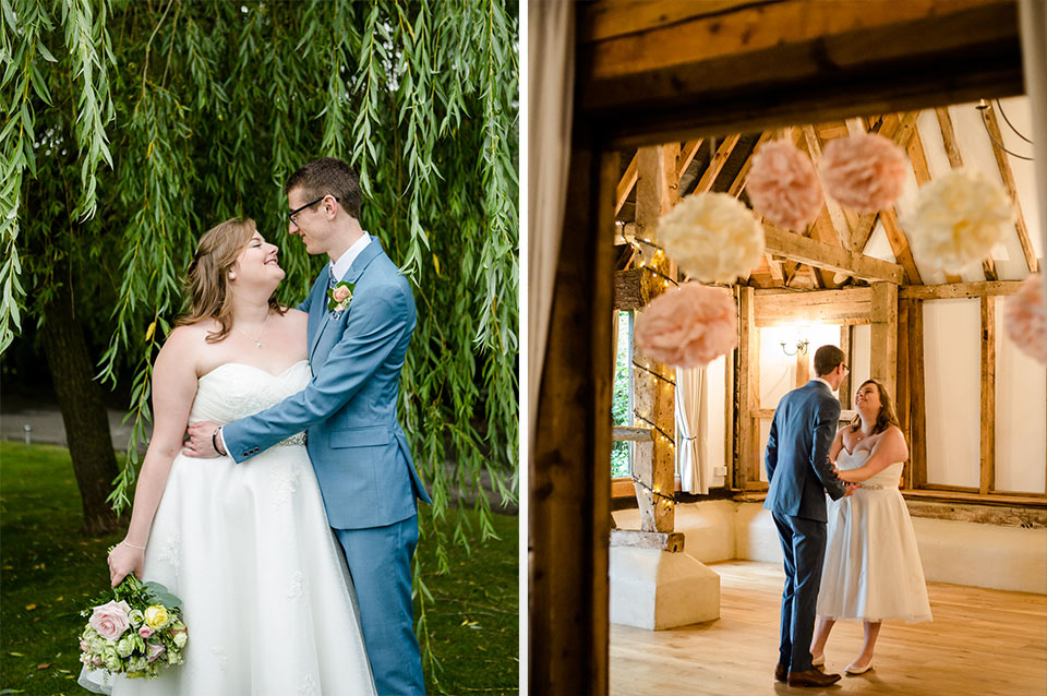 The delighted newlyweds steal a moment away from guests to embrace at their summer wedding