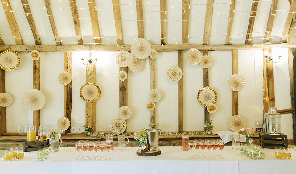 e452538b5f6 Pin wheels or paper cranes hung from the wall behind the top table create a  fun
