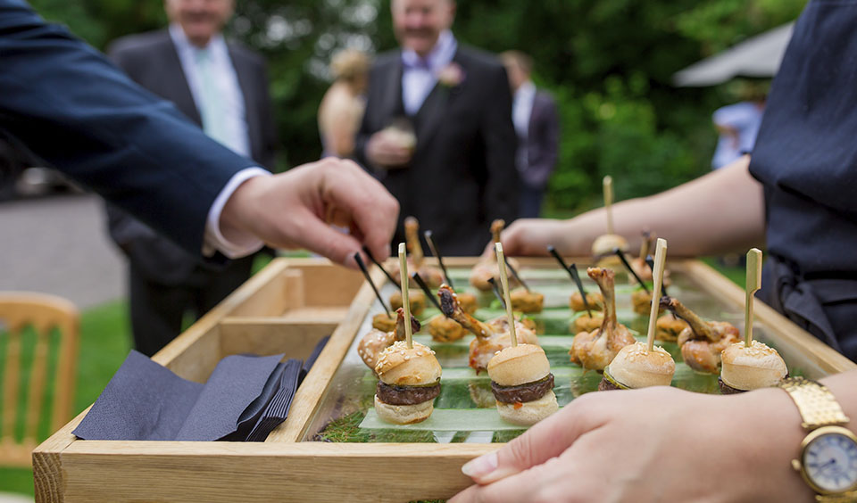 Guests enjoy delicious canapes after the wedding ceremony served by the Galloping Gourmet Team
