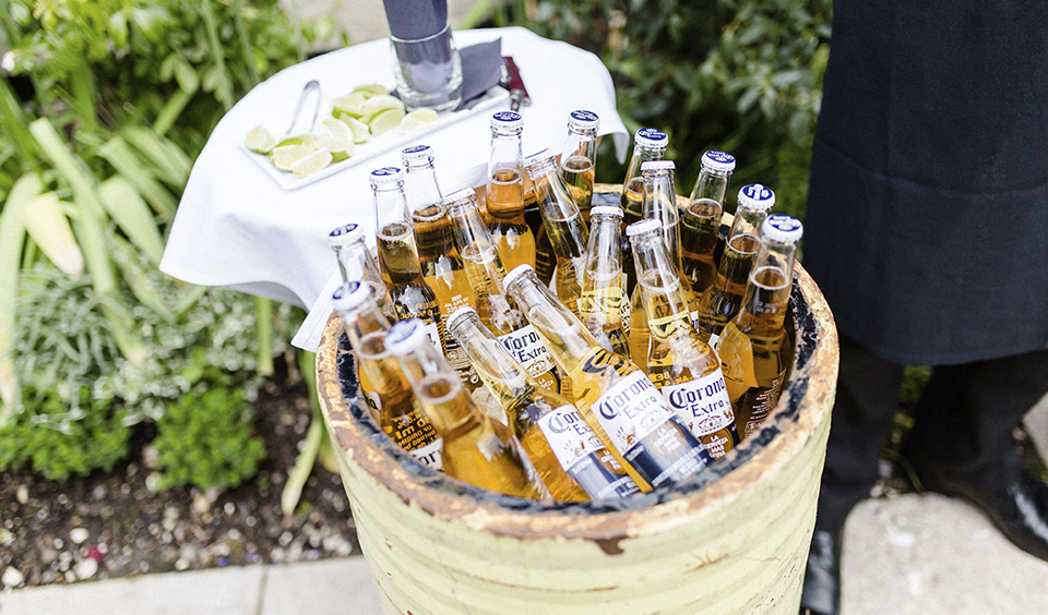 Cold drinks presented in funky metal beer barrels will keep guests cool in summer – wedding ideas