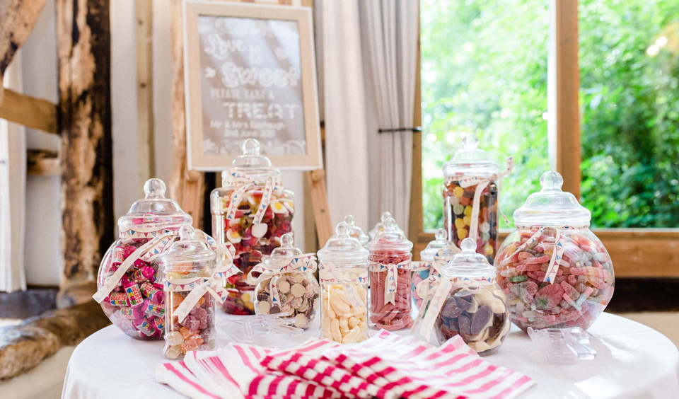 A sweetie cart or sweet buffet is the perfect wedding accessory for a romantically rustic wedding