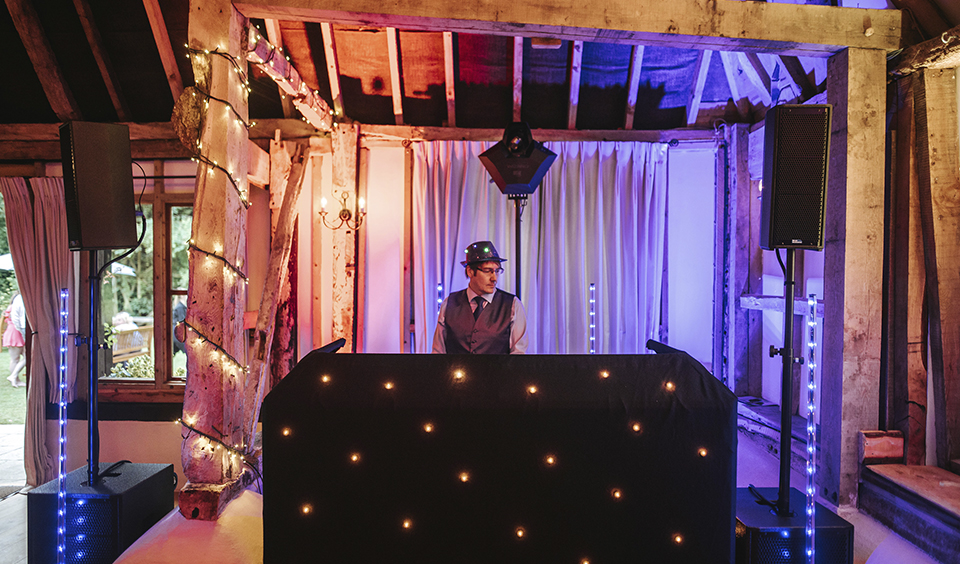 The DJ gets ready to play some hits for partygoers during the evening reception – party wedding venues