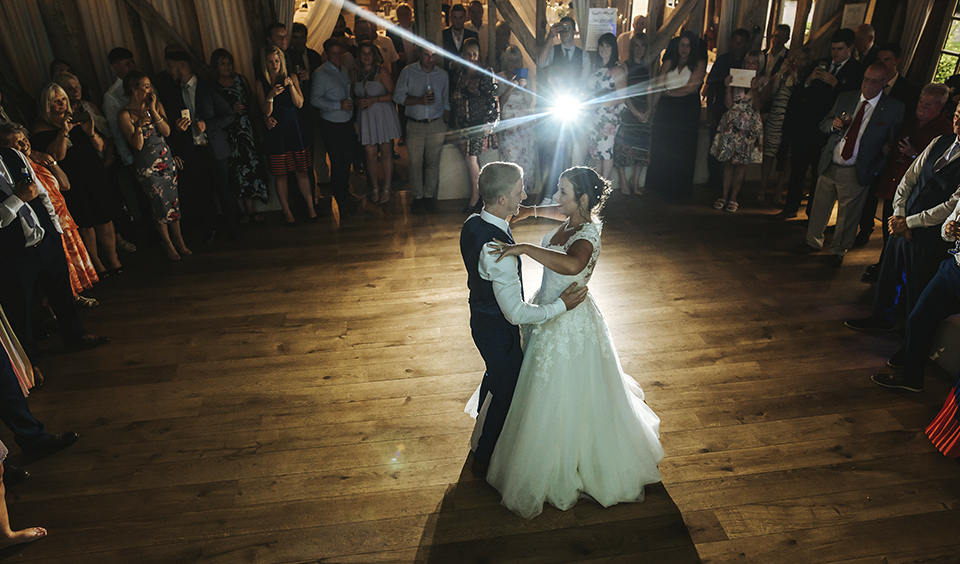 The bride and groom take to the dancefloor to enjoy their first dance as husband and wife