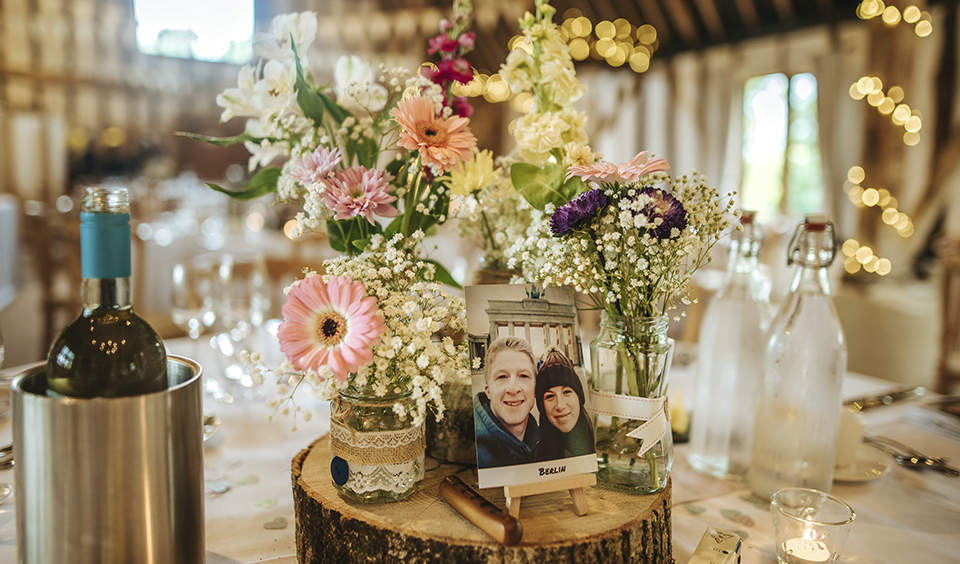 Keeping to a rustic wedding theme the wedding centrepieces consisted of flowers in glass jars – wedding ideas