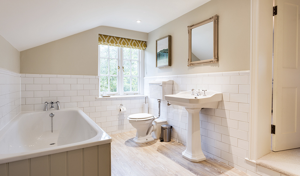 Guests can freshen up throughout the day in the Farmhouse bathrooms complete with large bath tub