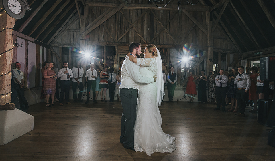 The bride and groom enjoy their first dance at the evening reception at Clock Barn Hampshire