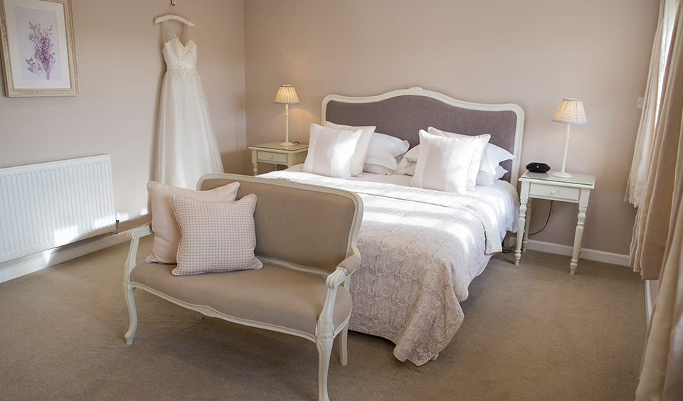 With its lavender colour scheme the Lavender Barn bedroom provides a romantic setting for the honeymoon couple
