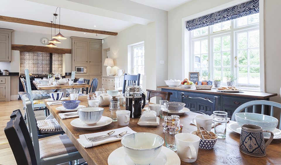 Kitchen dining table all laid out for you and your guests