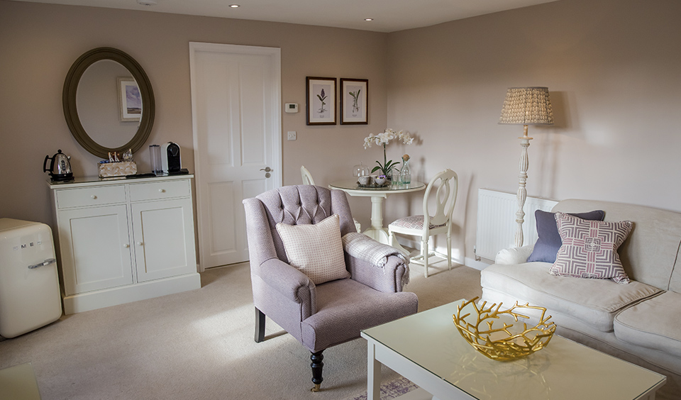 Take time to relax in the beautiful sitting room inside the Lavender Barn honeymoon suite