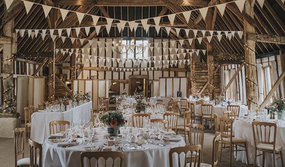 Clock Barn in Hampshire was beautifully decorated with white bunting and fairy lights