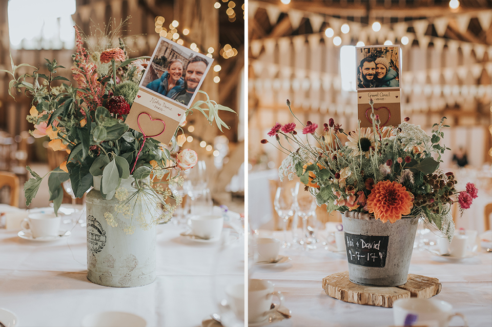 Rustic wedding flowers and photos of bride and groom were used as table centrepieces at Clock Barn Hampshire