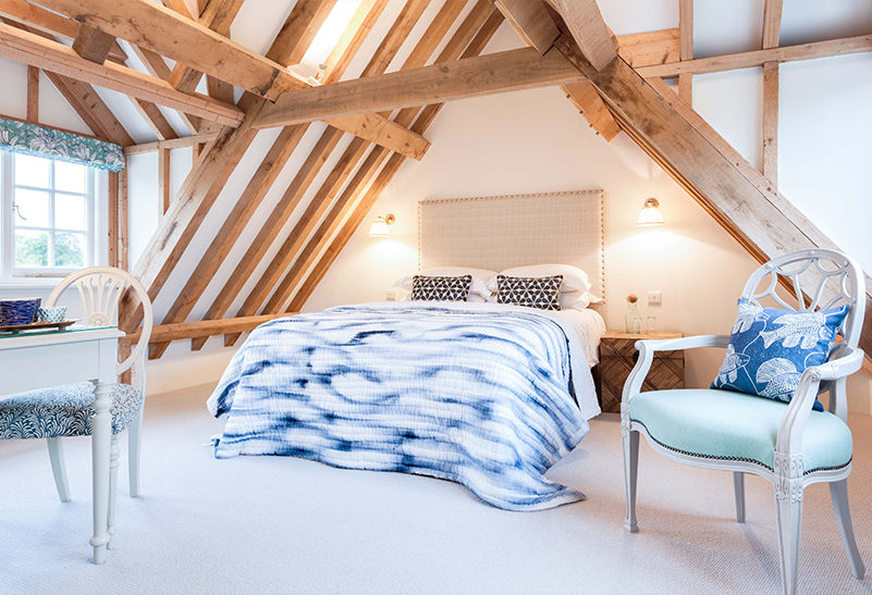 Bedrooms in the Tufton Warren Farmhouse at Clock Barn are each decorated with a neutral warm colour palette