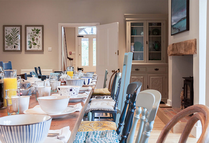 The kitchen in the Tufton Warren Farmhouse is set up for a family breakfast the morning after a wedding day