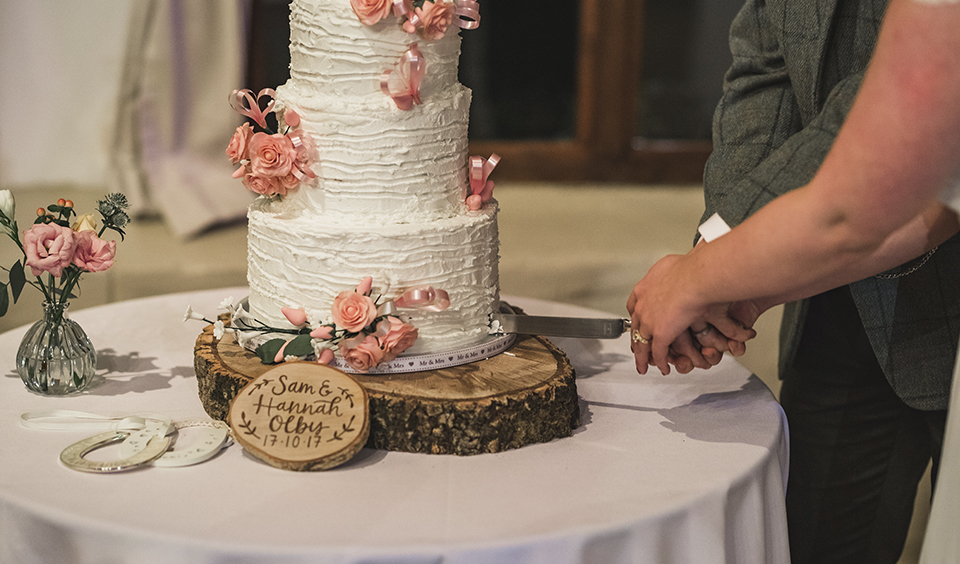 A simply elegant wedding cake looks beautiful set on a wood slice for more natural look