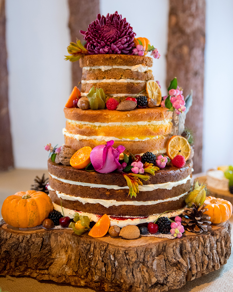 Miniature pumpkins add the finishing touch to your seasonally decorated naked wedding cake
