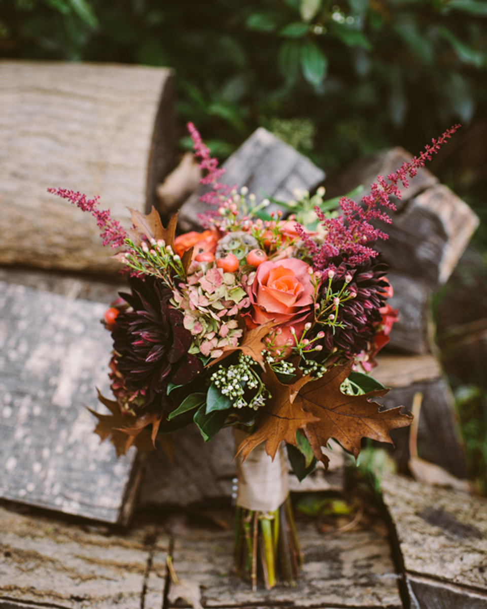 Deep purple and blush coloured flowers tied with seasonal leaves make the perfect autumnal wedding bouquet