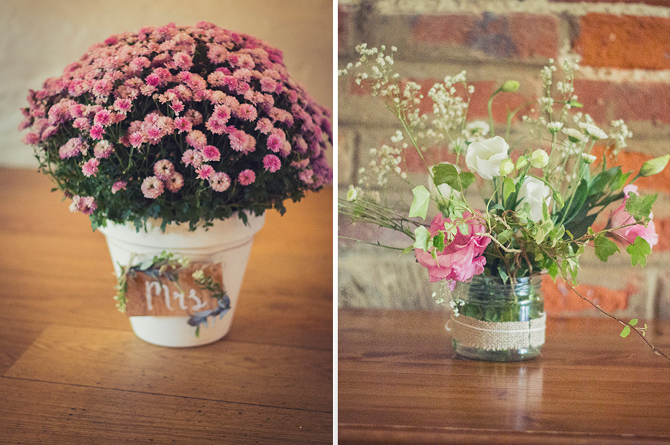 Pretty potted plants and delicate flowers in jars were used to decorate the barn at Clock Barn Hampshire