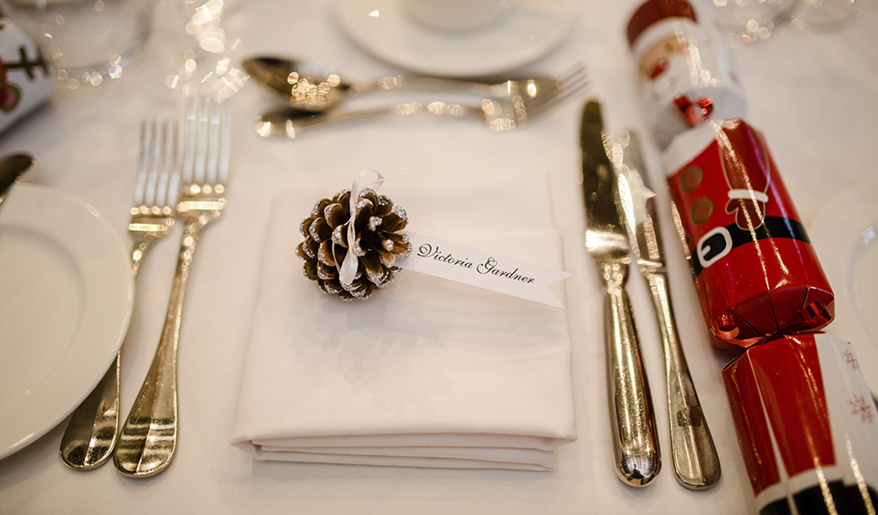 Using crackers and pine cones to decorate your place settings are simple but effective ideas for that festive feel at your winter barn wedding