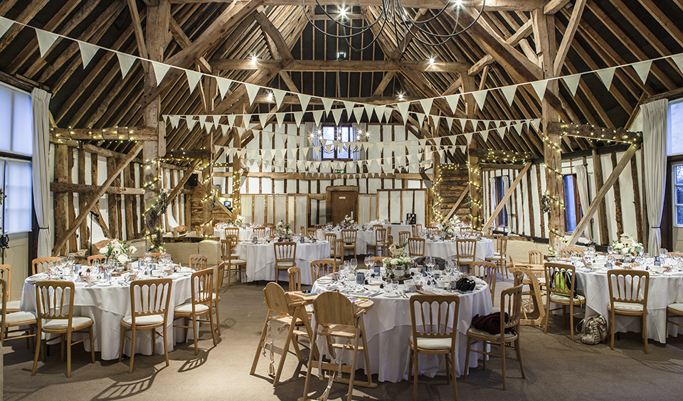 Decorate your winter barn wedding at Clock Barn with twinkly fairy lights and bunting