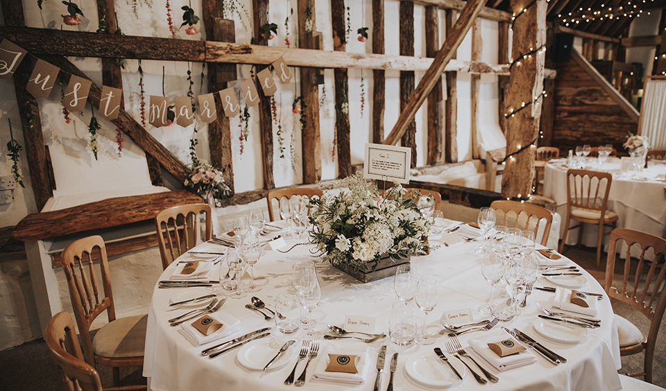 Clock Barn in Hampshire was decorated with rustic wedding flowers and natural coloured items for the wedding reception