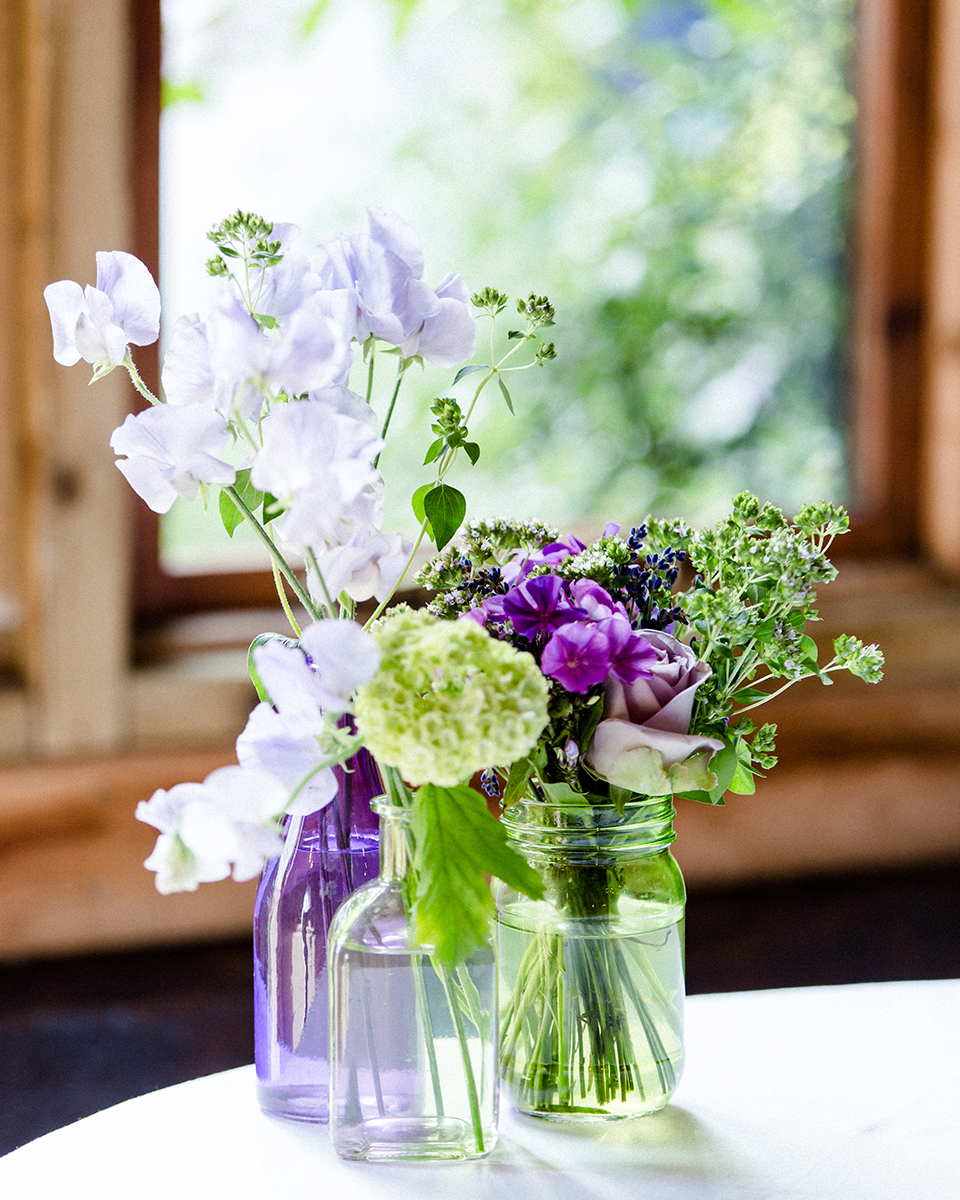 Lavender and cream blooms with seasonal foliage make the prettiest wedding bouquet for your wedding at Clock Barn