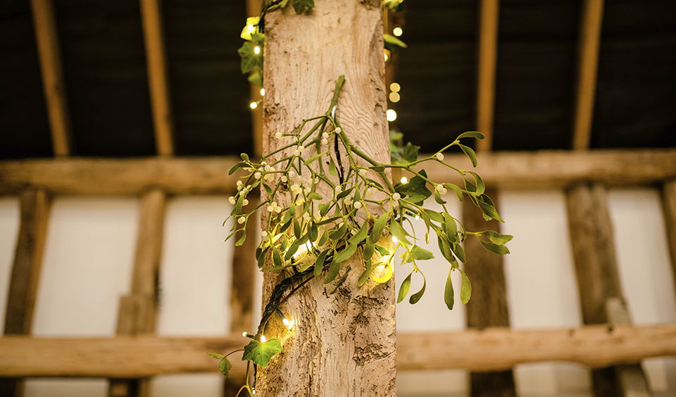 What could be more perfect than a sprig of mistletoe hung in the barn at your winter wedding at Clock Barn in Hampshire