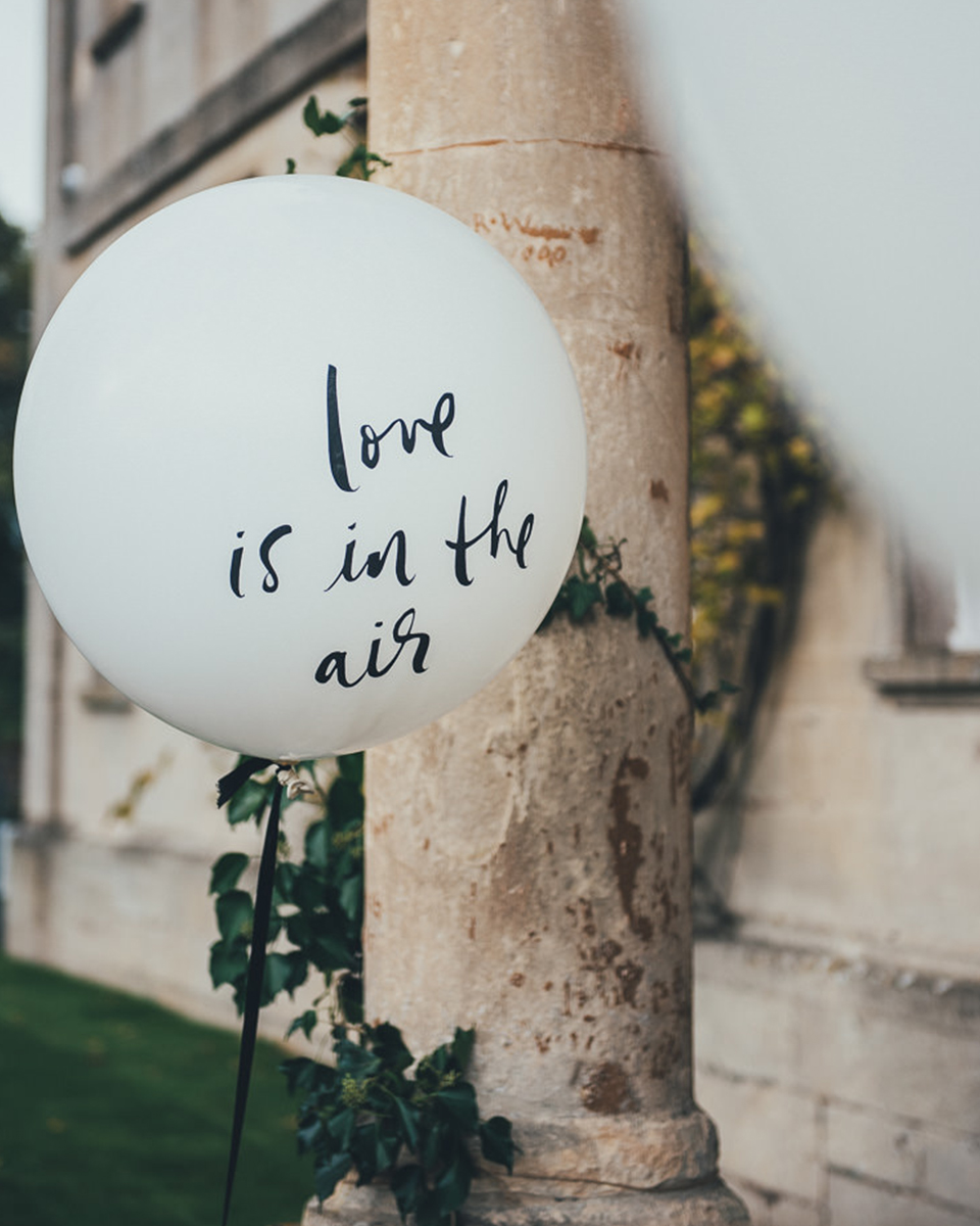 Decorate the venue with wedding balloons with sweet messages on for that romantic touch to your barn wedding Hampshire